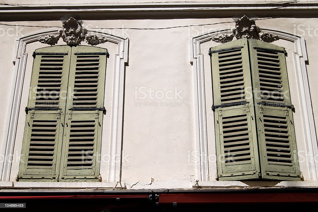 Old fashioned shutters on windows. Cannes. France stock photo