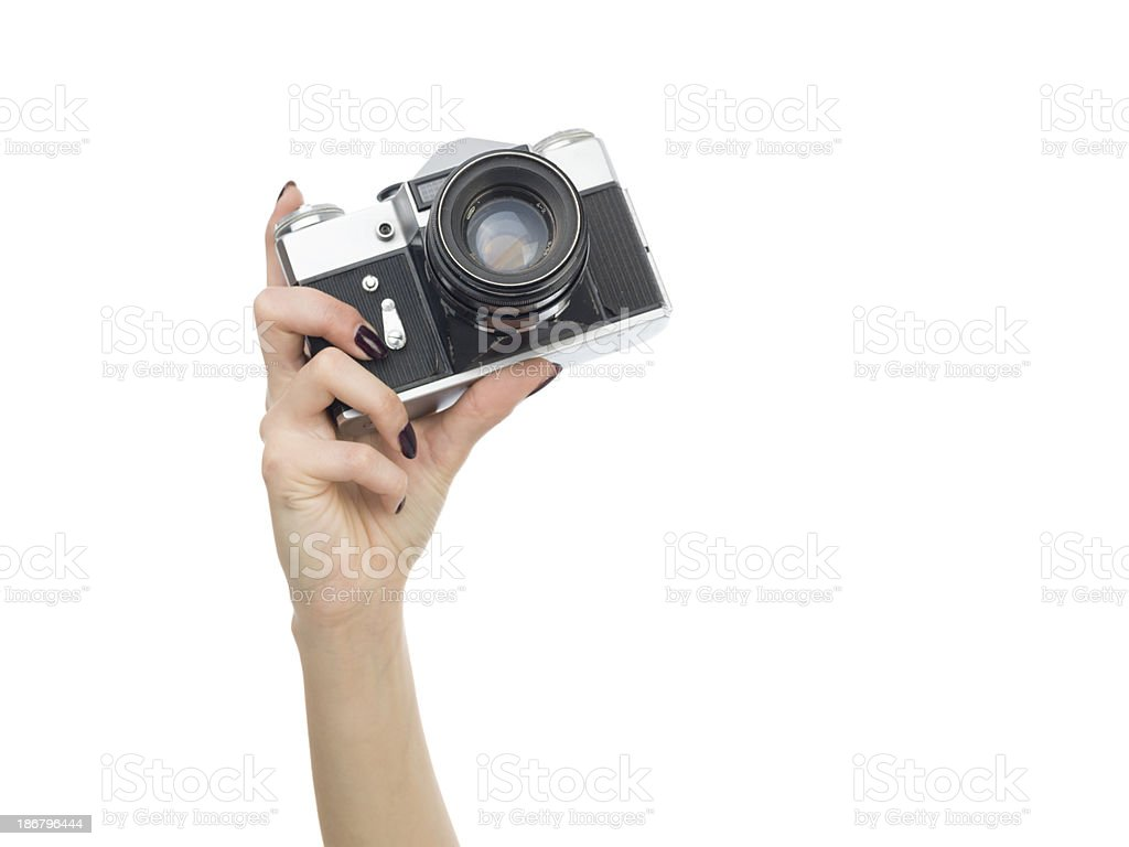 Old fashioned SLR camera in human hand royalty-free stock photo