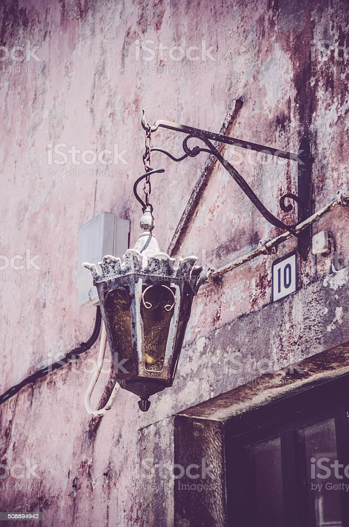 Old fashioned street light with house nomber stock photo