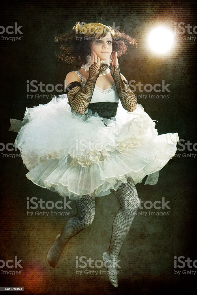Old Fashioned Teenage Girl Wearing Period Costume Jumping stock photo