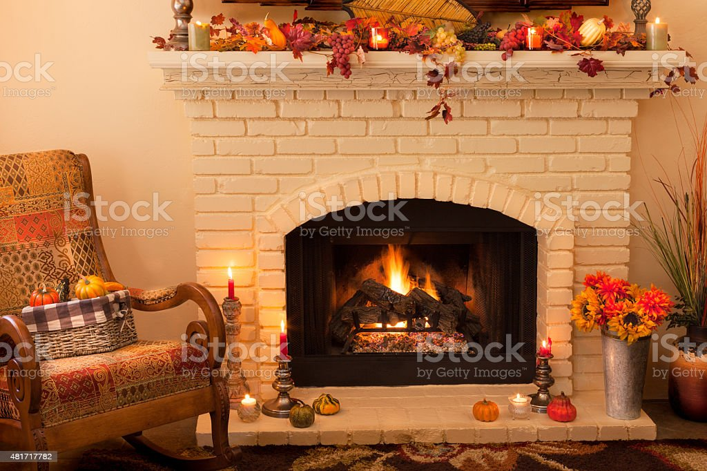 Old fashioned Thanksgiving fireplace and rocker in morning light -(P) stock photo