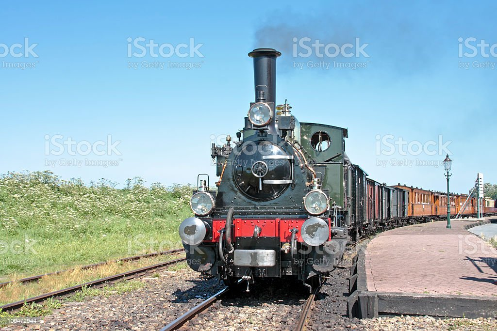 Old fashioned train driving in the countryside from Netherlands royalty-free stock photo