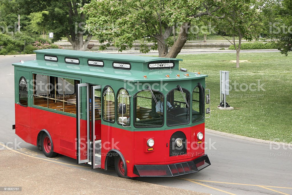 Old fashioned trolley in a park setting stock photo