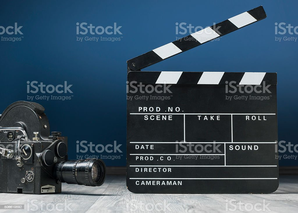 Old Fashioned Video Camera And Film Slate On The Floor stock photo