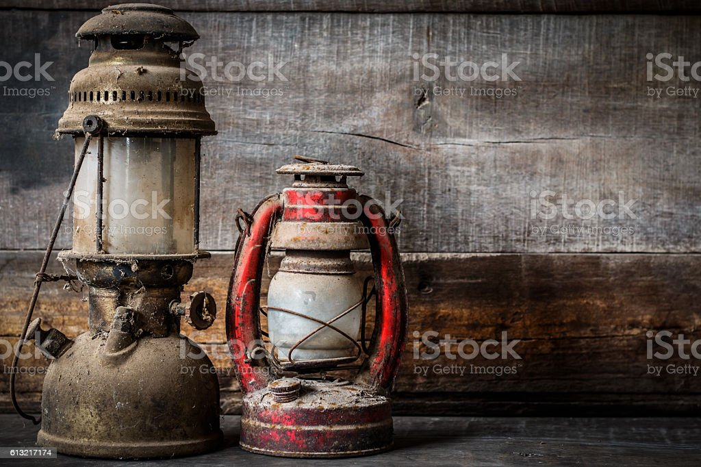 Old fashioned vintage kerosene oil lantern lamp burning stock photo