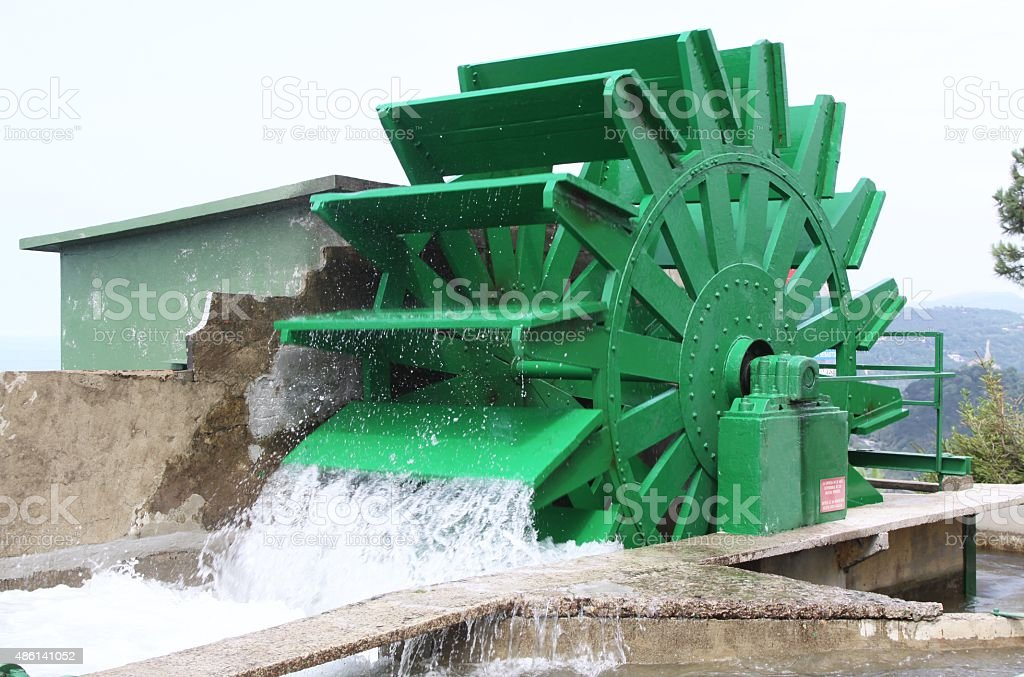 Old Fashioned Water Wheel For Irrigation stock photo