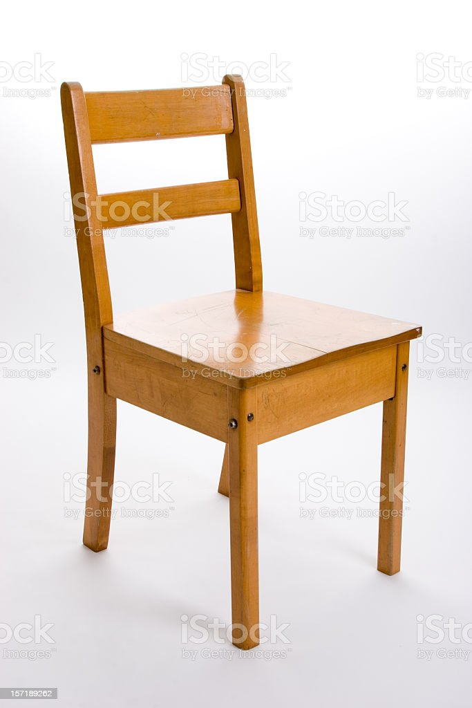 Old fashioned wood school chair stock photo