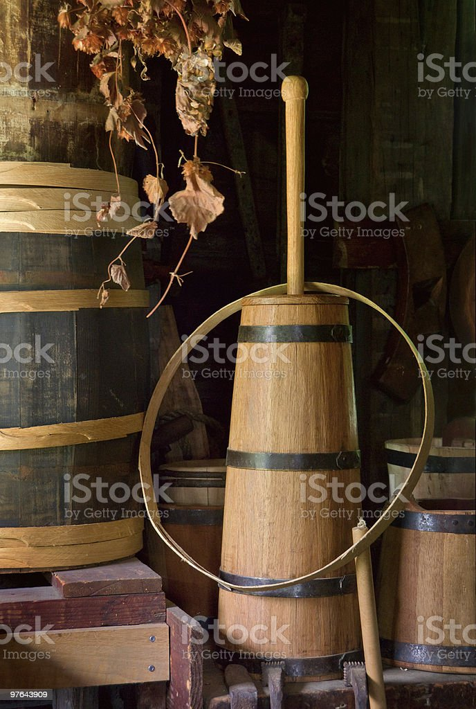Old fashioned wooden butter churn and barrels stock photo