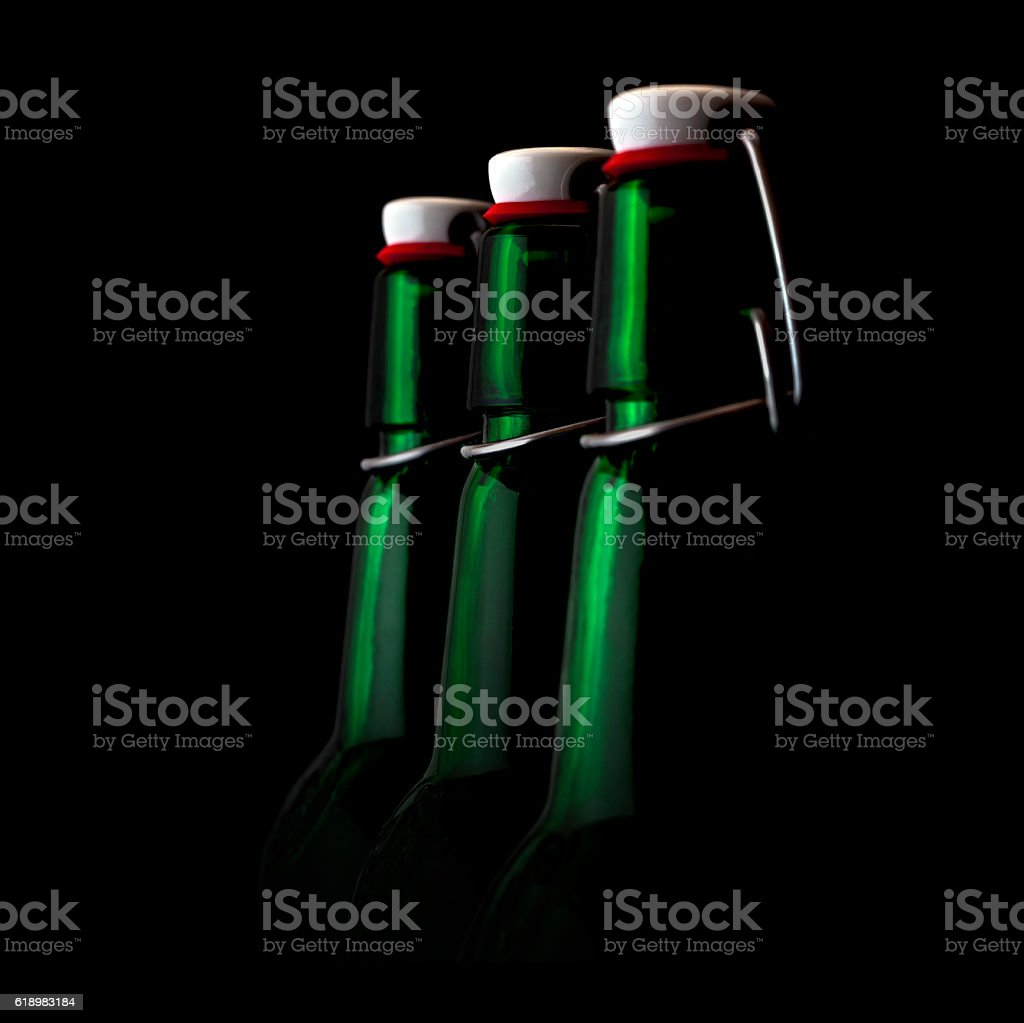 Old fasion green bottles on a black background stock photo
