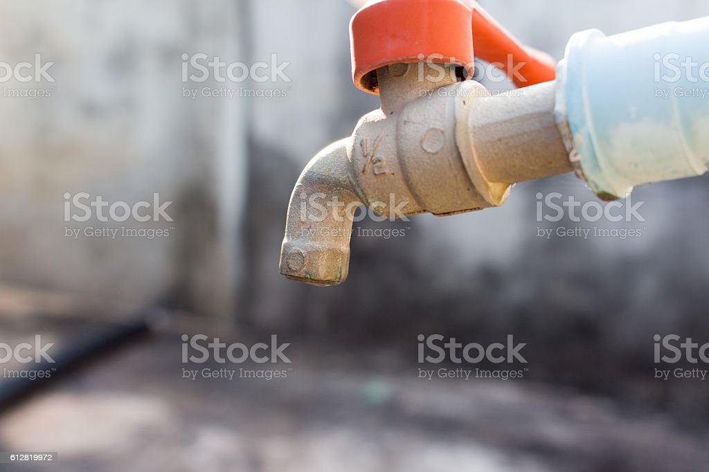 Old faucet stock photo