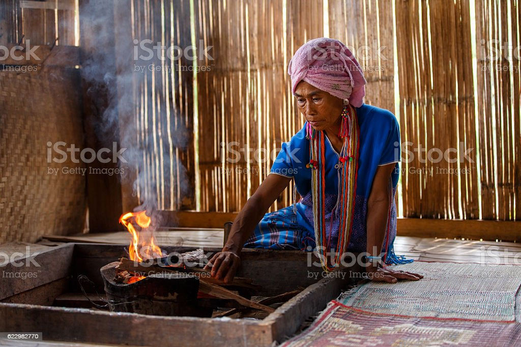 Old female karen hill tribe is cooking traditional stock photo