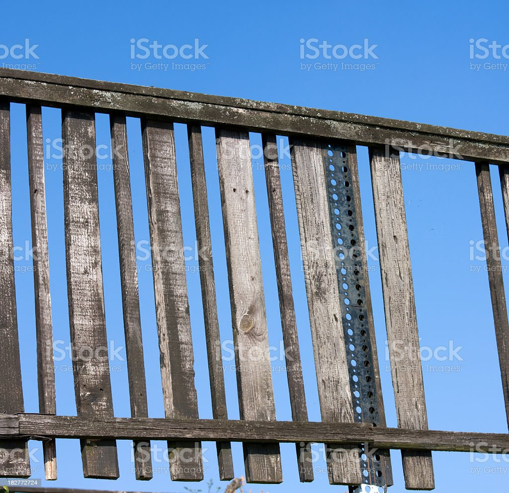 old fence and blue sky royalty-free stock photo