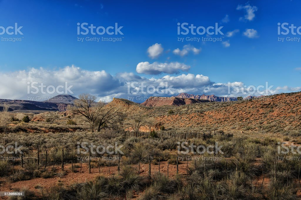 Old Fence and Red Rock View stock photo