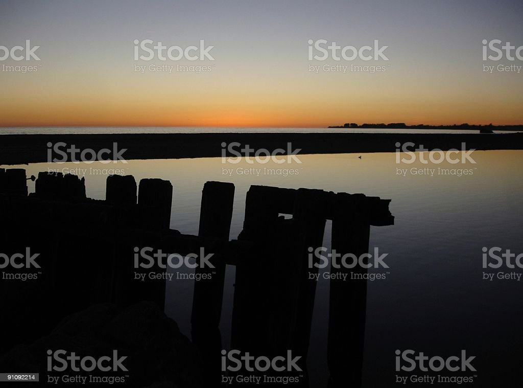 Old fence at sunset on California coast royalty-free stock photo