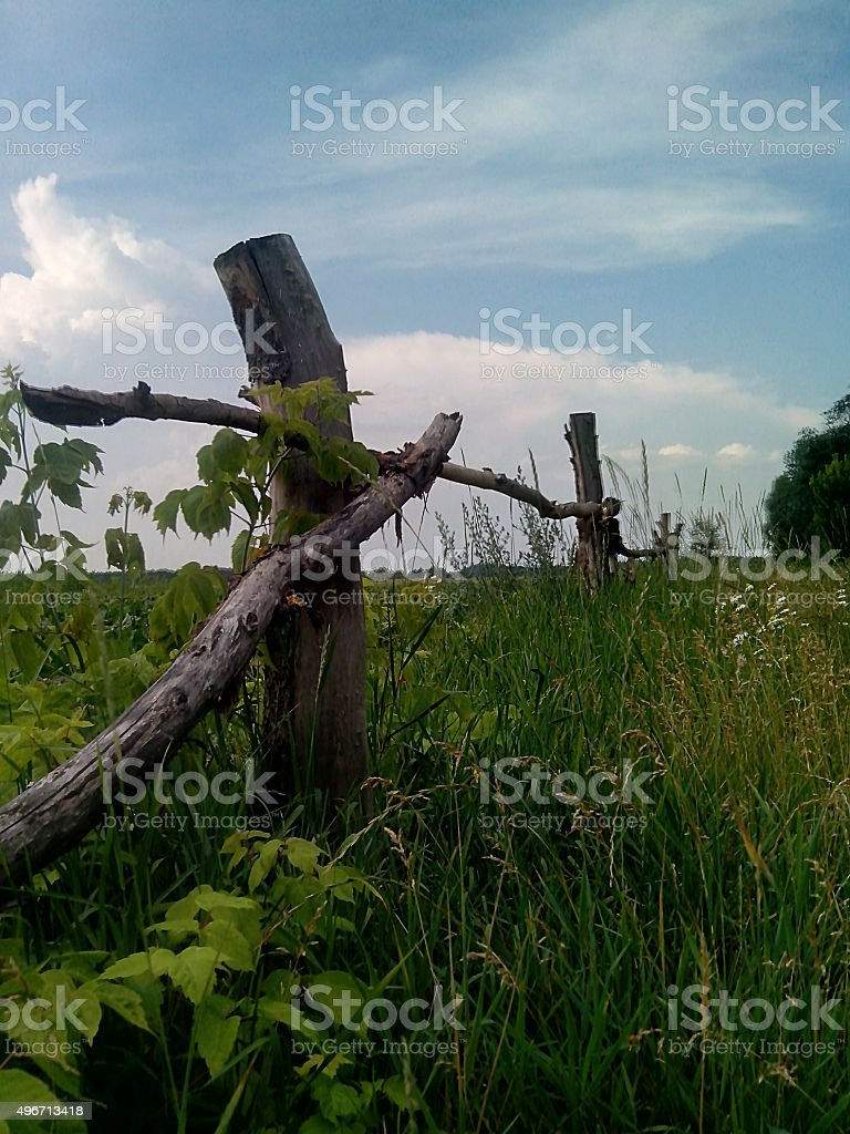 old fence near the field stock photo