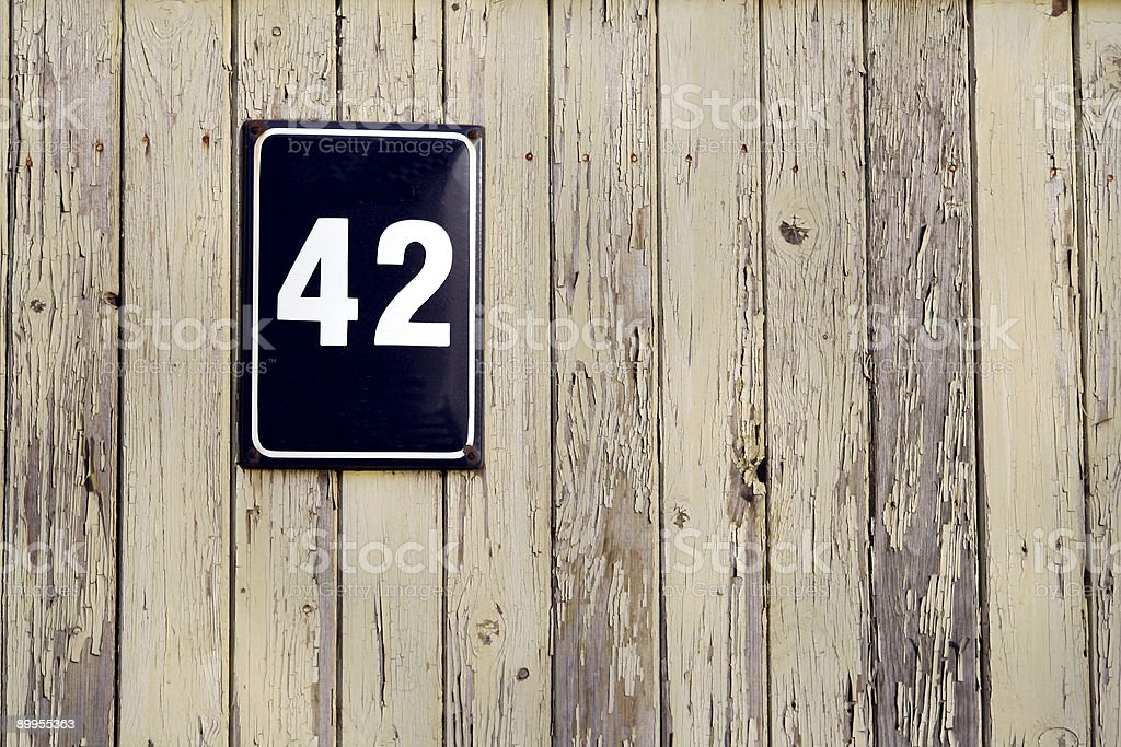 Old fence with street number royalty-free stock photo