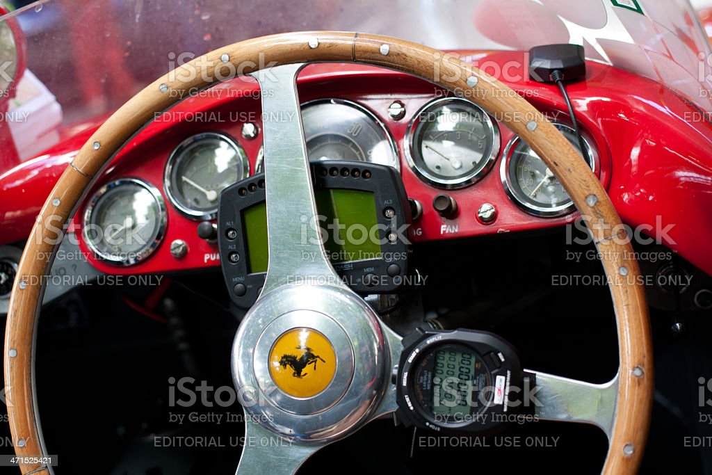 Old Ferrari instrument panel detail at Mille Miglia stock photo
