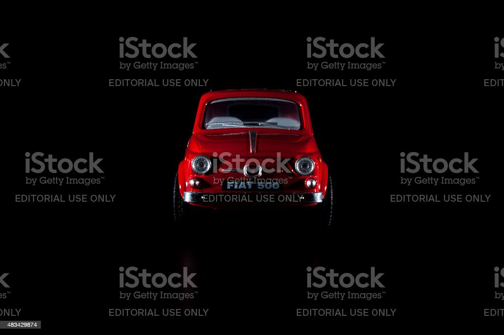 Old Fiat 500 toy car, low key photography. stock photo