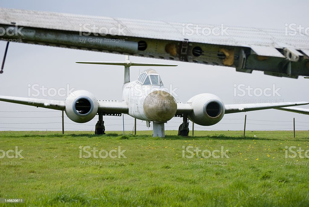 Old fighter plane in field royalty-free stock photo