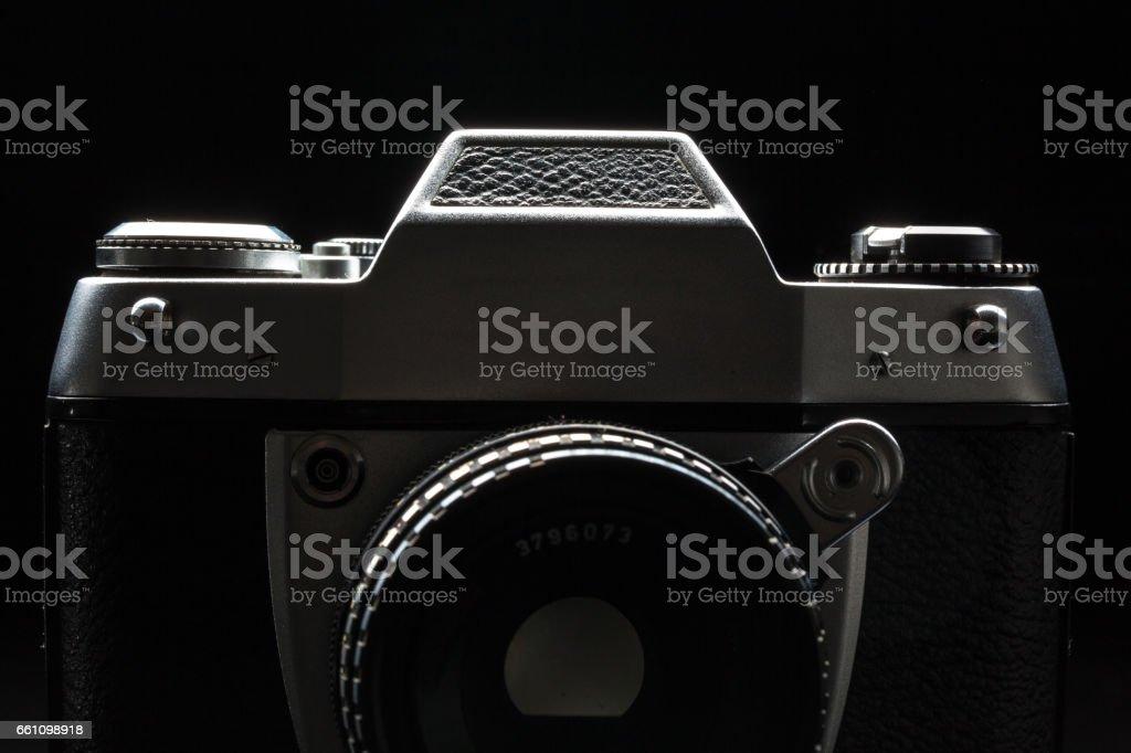 Old film camera - low key image stock photo