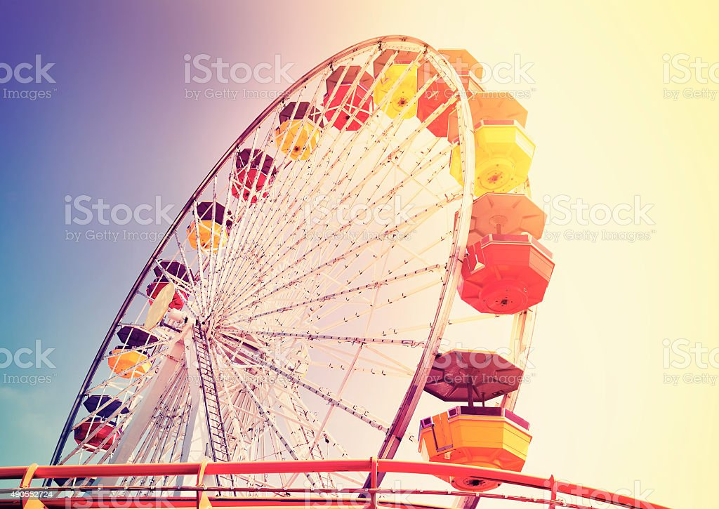 Old film retro style picture of an amusement park. stock photo