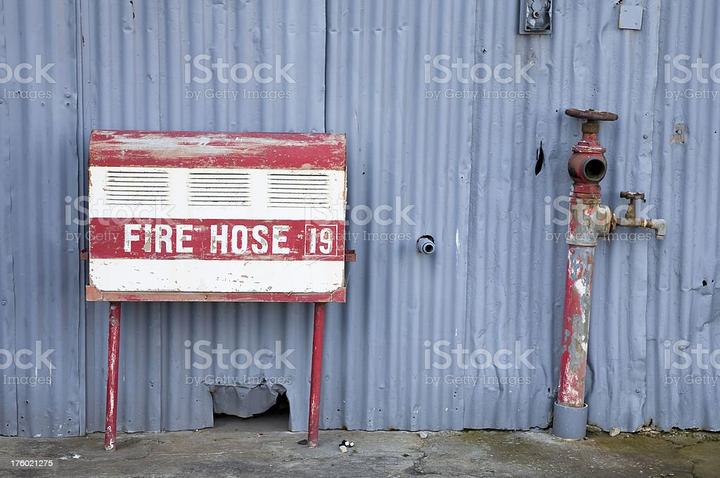 Old fire hose stock photo