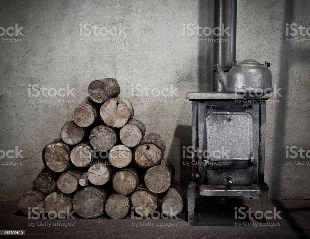 Old fire with wood stack stock photo