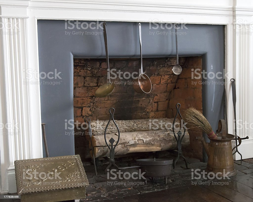 Old fireplace with logs royalty-free stock photo