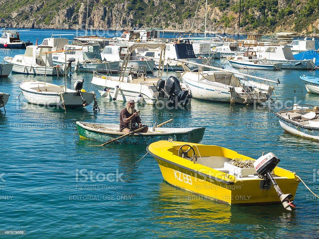 Old fisharman in Komiza port on Adriatic coast in Croatia stock photo