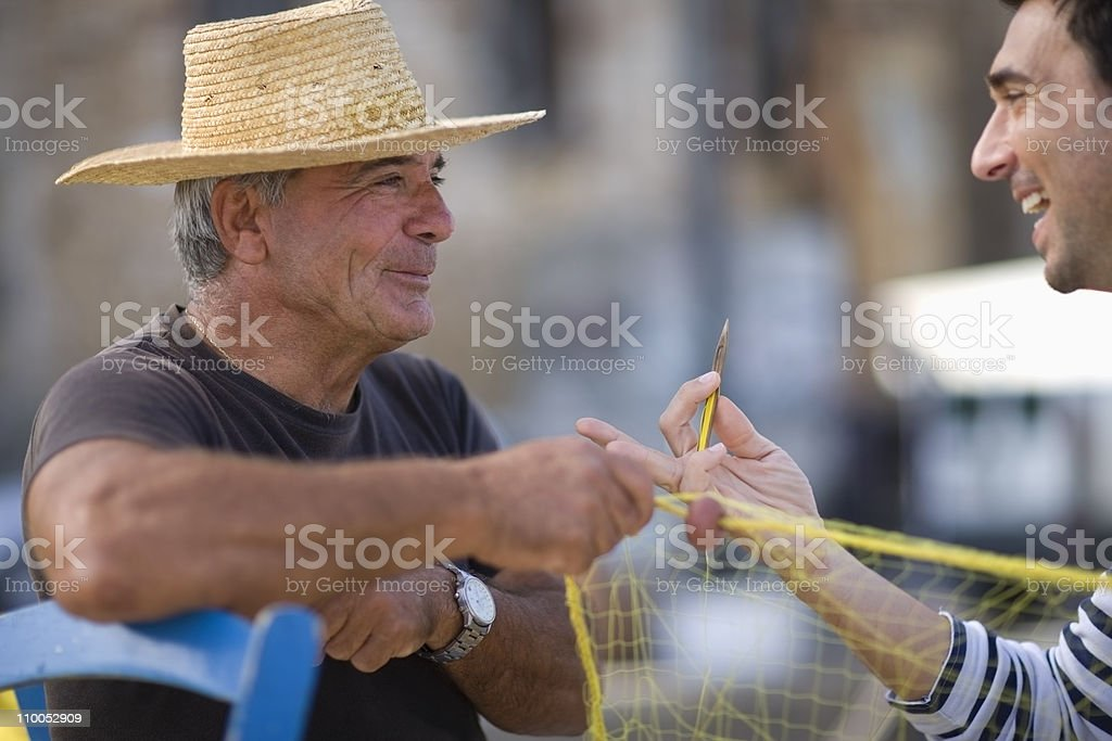 Old fisher stock photo