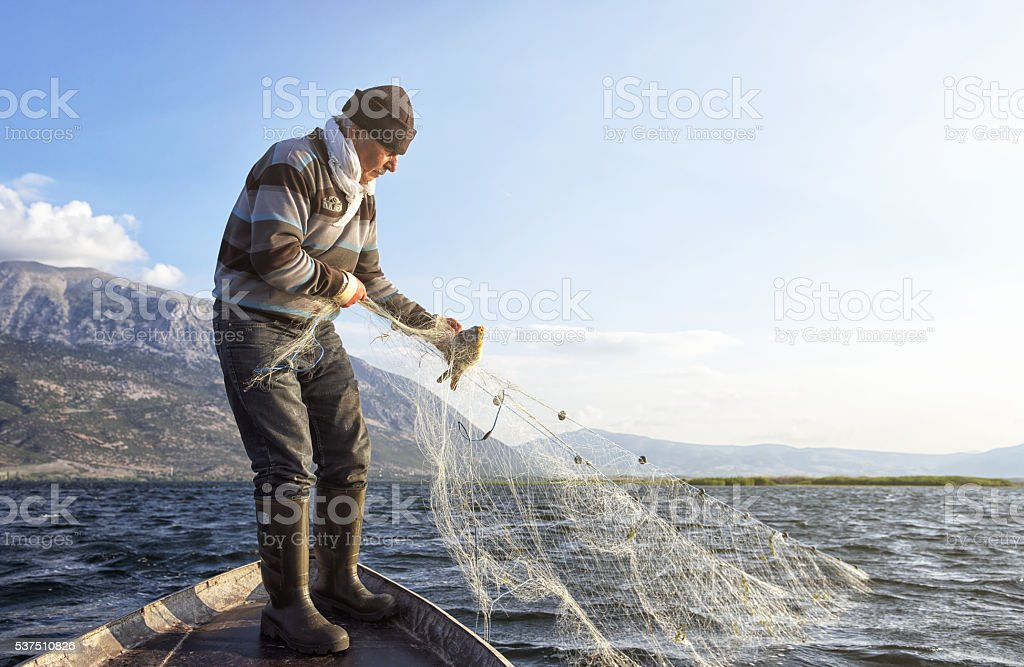 Old Fisherman on His Boat stock photo