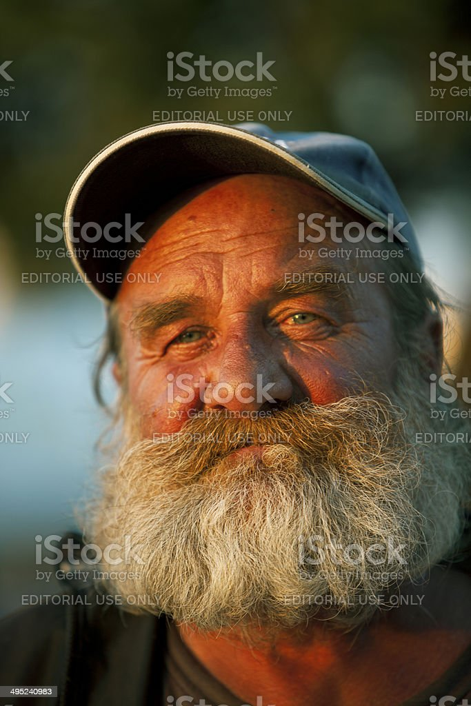 Old fisherman stock photo