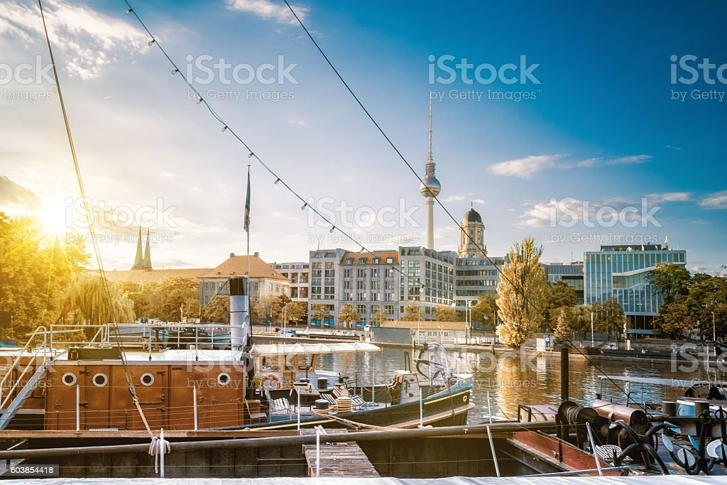 old fishermans boats in  berlin with view on tv-tower stock photo