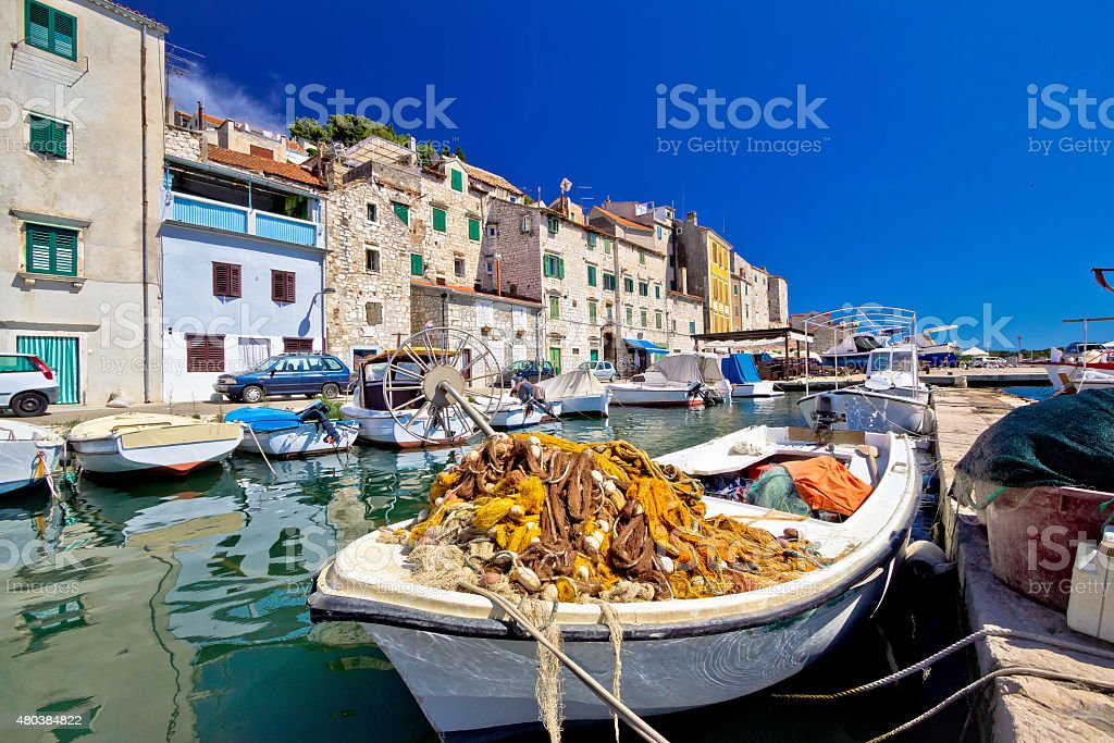 Old fishermen harbor in Sibenik stock photo