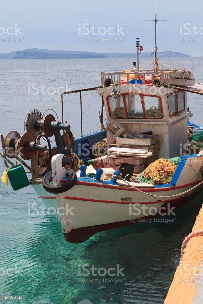 Old fishing boat at the port of Ammoudi, Santorini stock photo