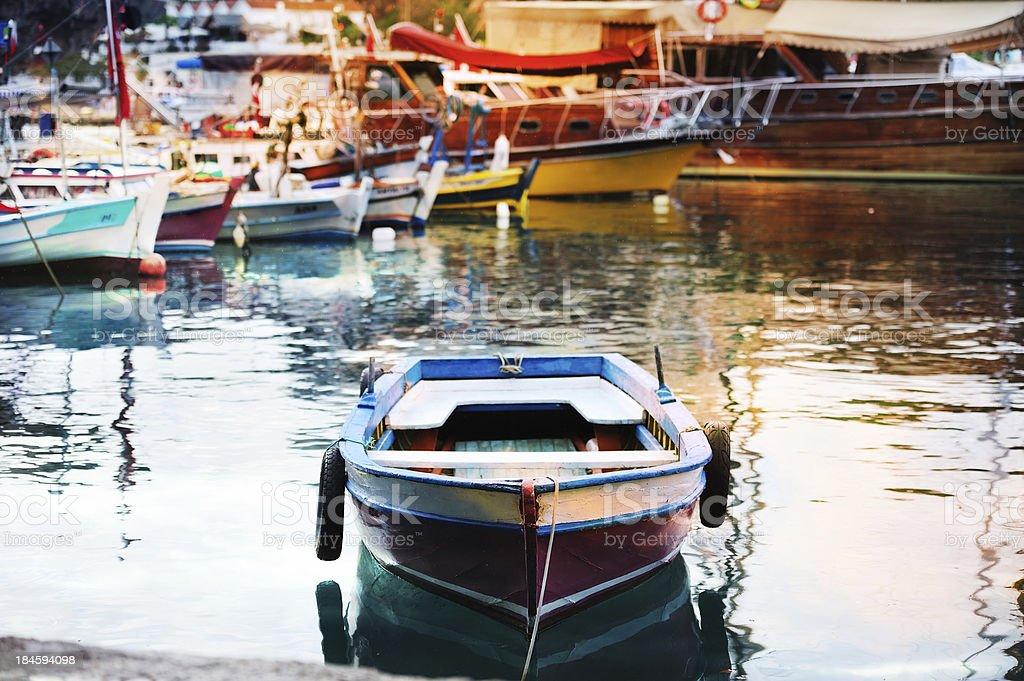 Old fishing boat in port stock photo