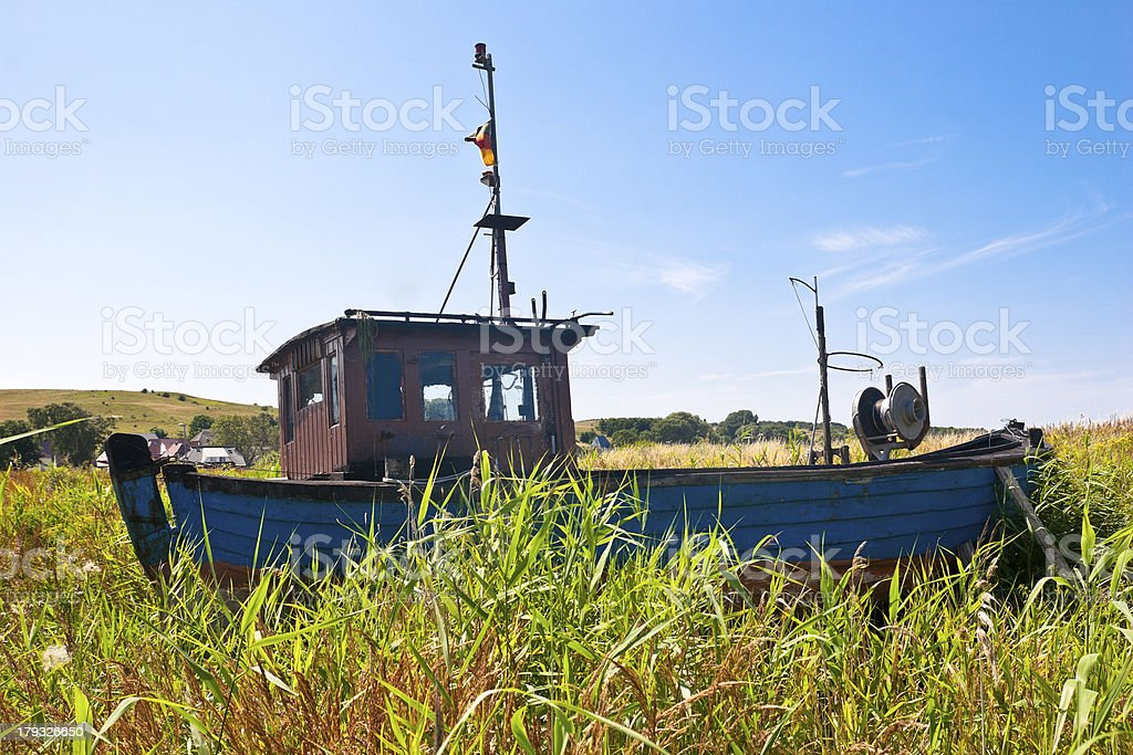 Old fishing boat moored in the reeds royalty-free stock photo