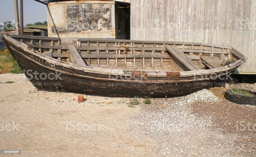 Old fishing boat on a sandy beach stock photo