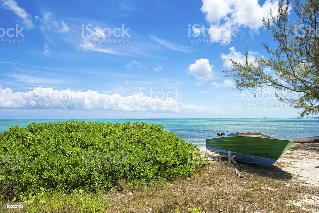 Old fishing boat on a tropical beach at the Caribbean royalty-free stock photo