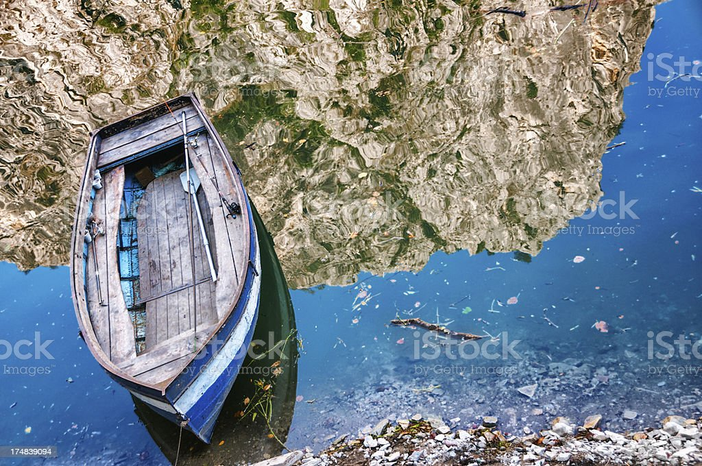 Old Fishing Boat Resting in the Lake royalty-free stock photo
