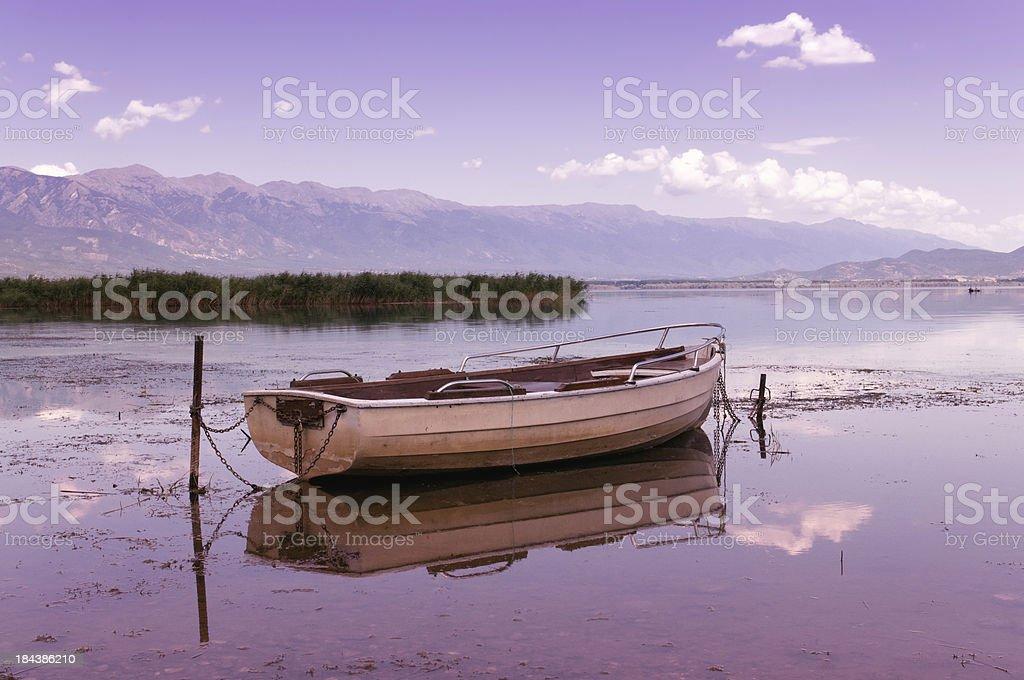 Old Fishing boat resting on beautiful sunset royalty-free stock photo
