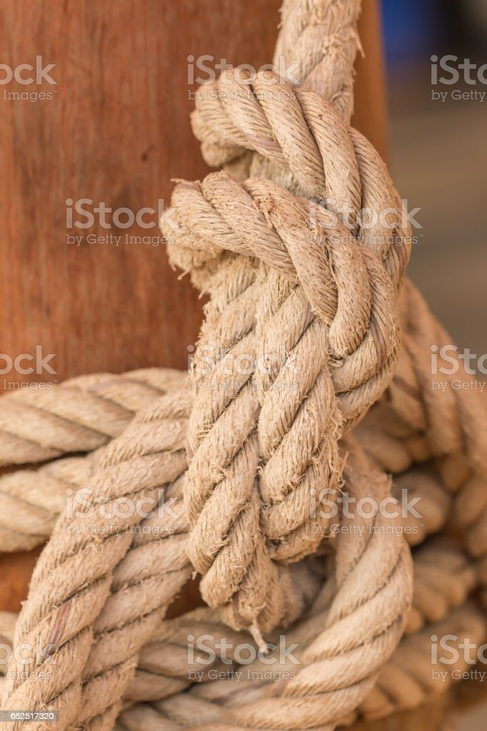 Old fishing boat rope with a Tied Knot stock photo