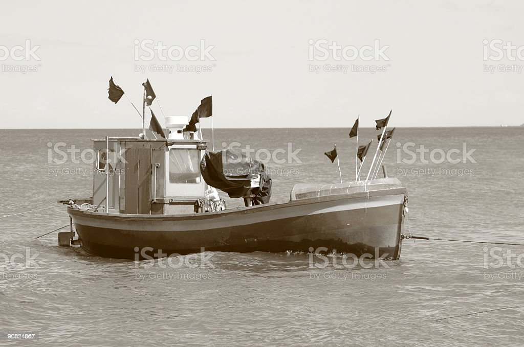 old fishing boat - sepia tone royalty-free stock photo