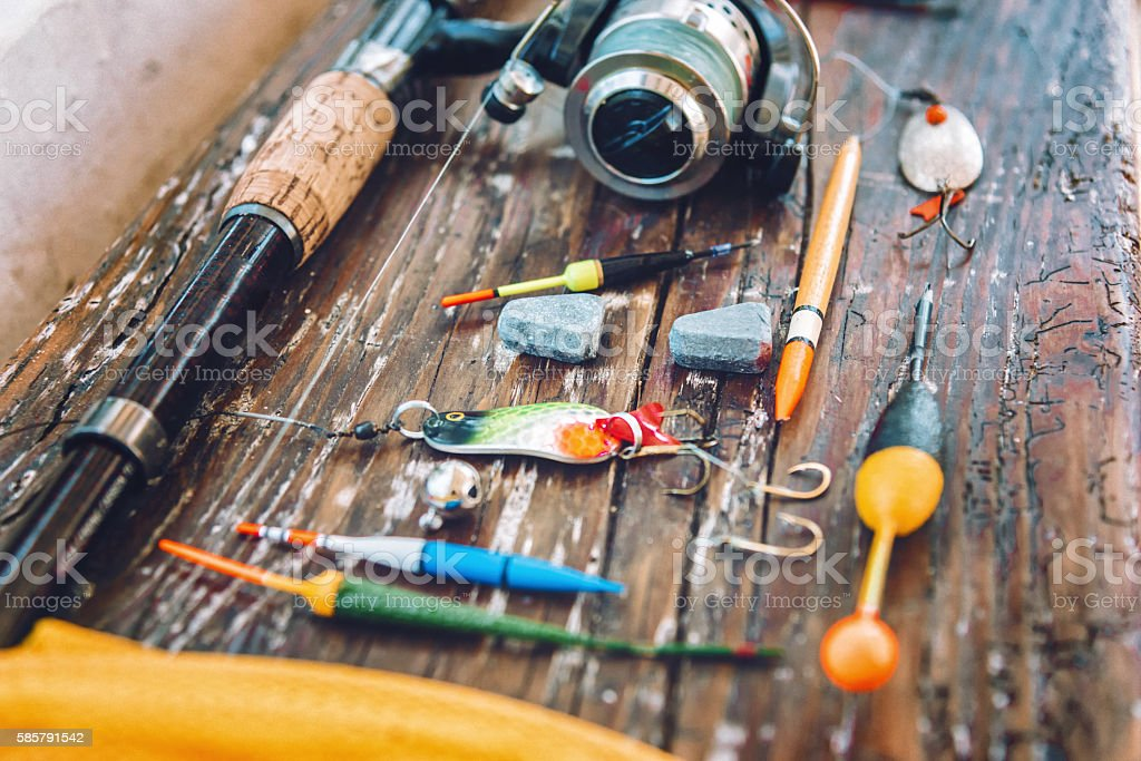 old fishing equipment on wooden board stock photo