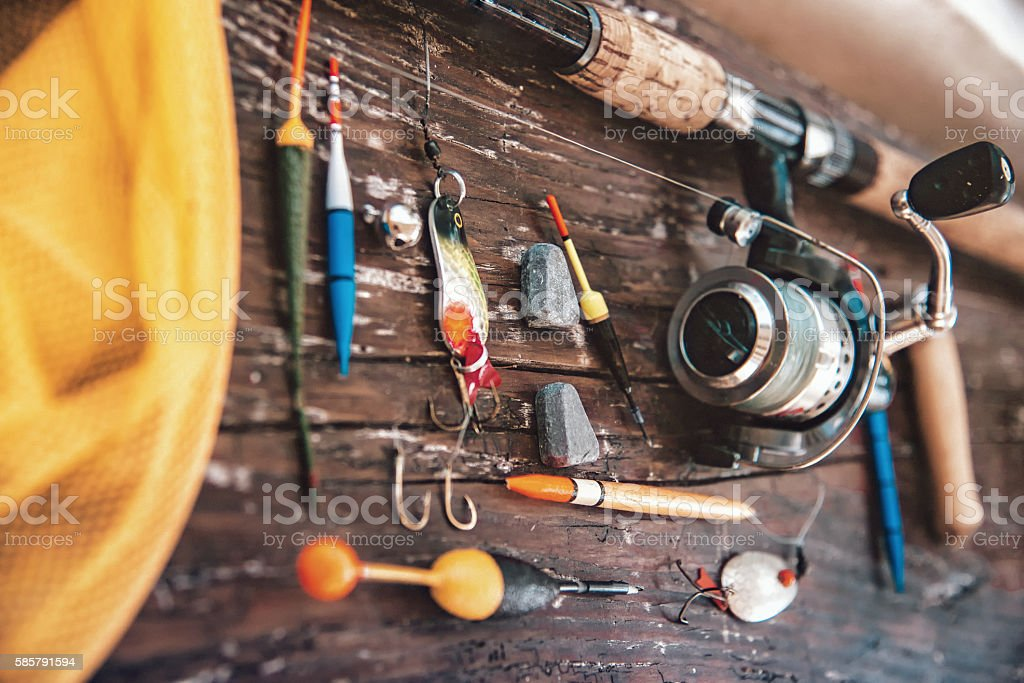 old fishing equipment on wooden plank stock photo