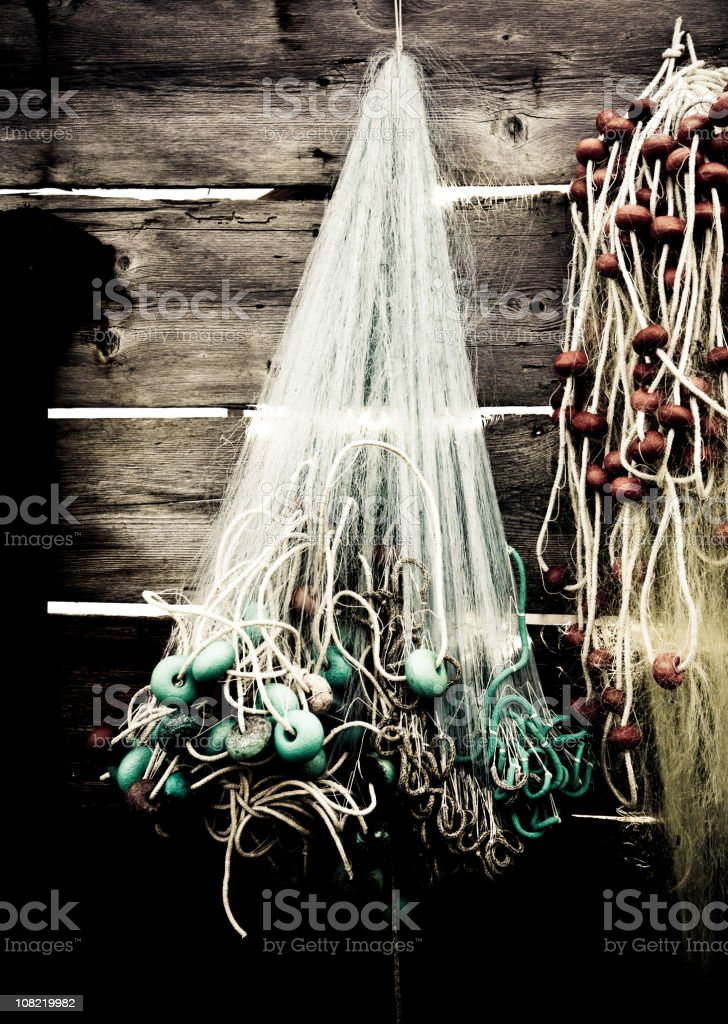 Old Fishing Nets Hung on Rack of Wooden Building stock photo