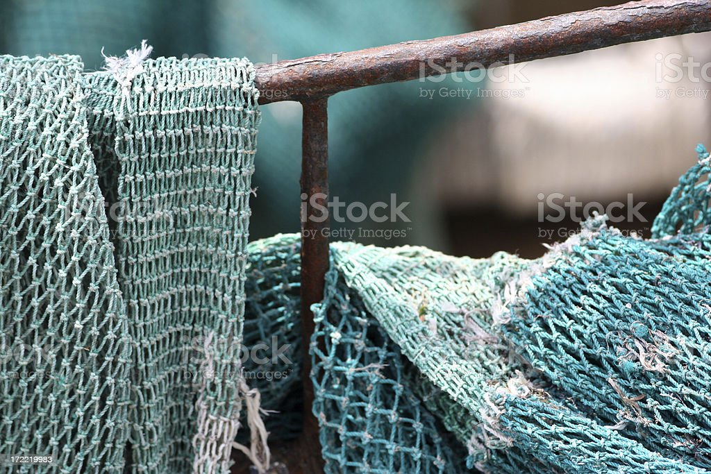 Old fishing nets on rail royalty-free stock photo