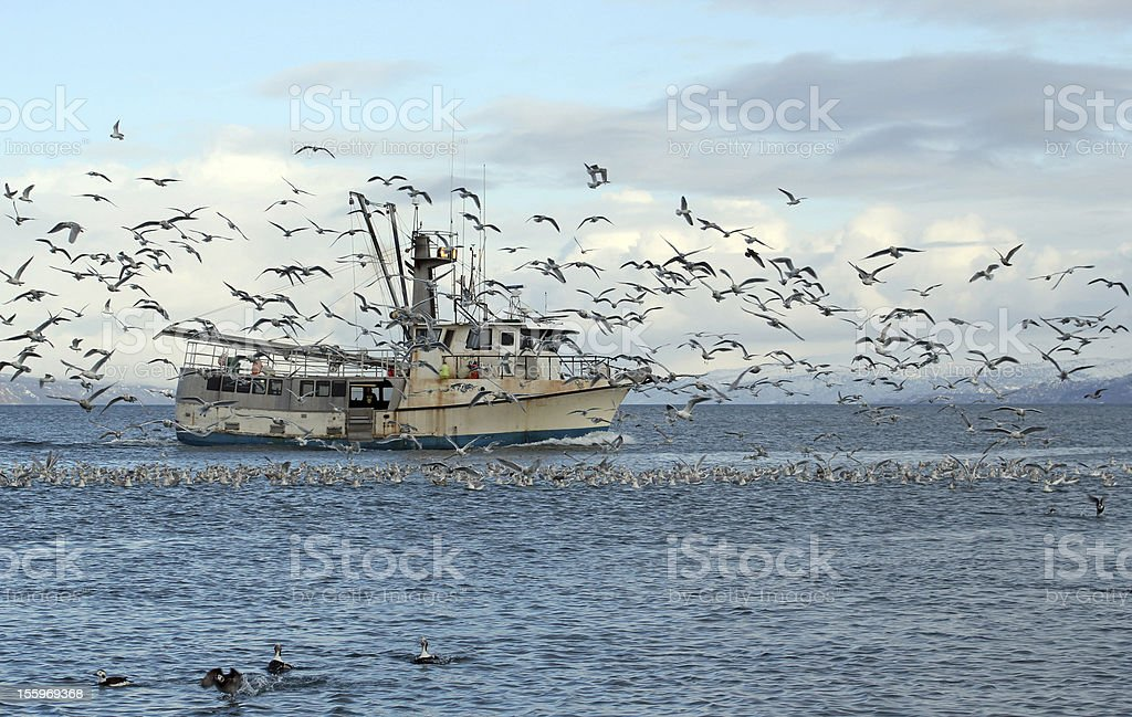 Old fishing trawler in Alaska stock photo