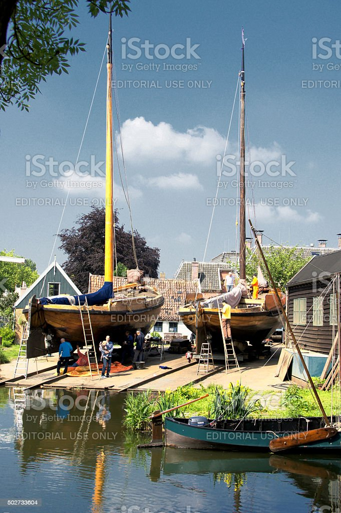 Old fishing vessels on a shipyard stock photo