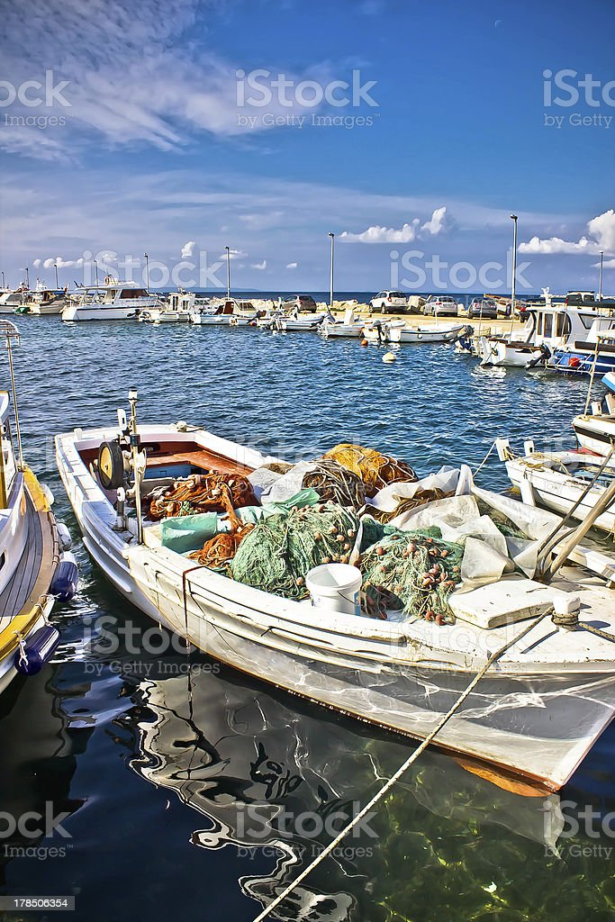 Old fishing wooden boat with nets royalty-free stock photo